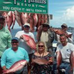 Group posing with catch of snapper