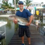 Posing with an Amberjack fish